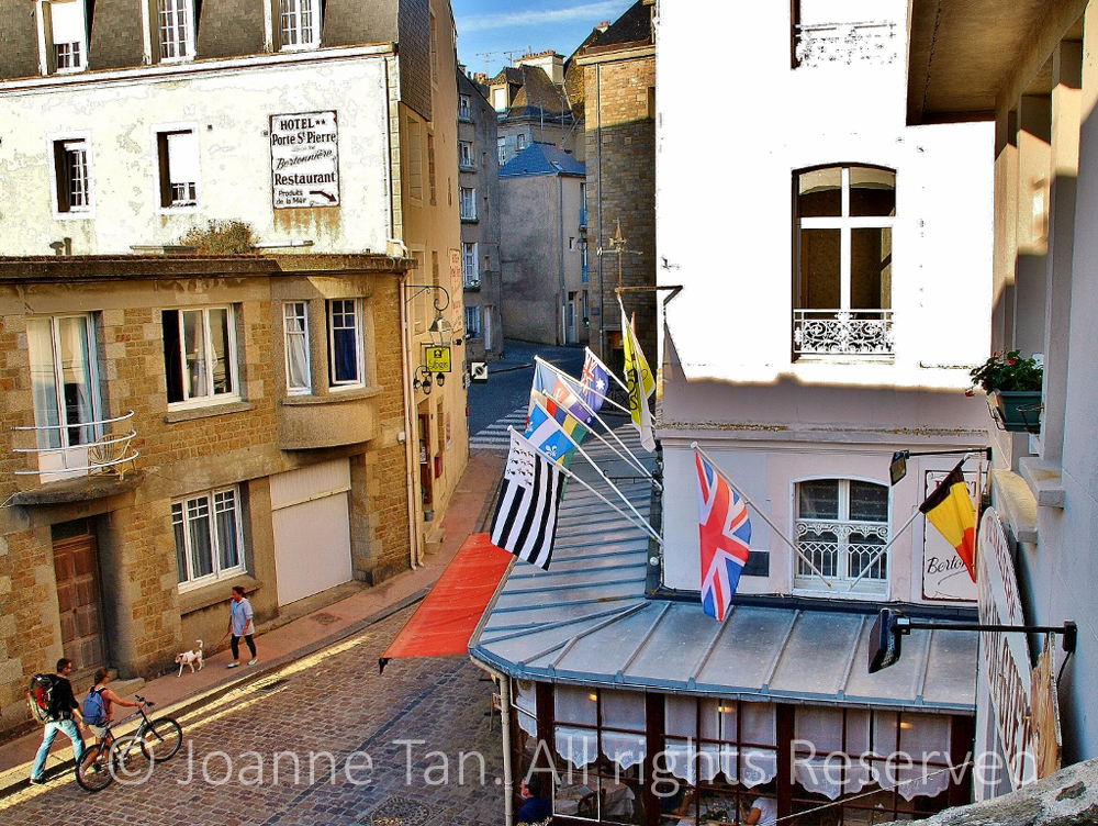 p- architecture - cityscape - French Street scene - Restaurant - national flags - St. Malo, Brittany, France
