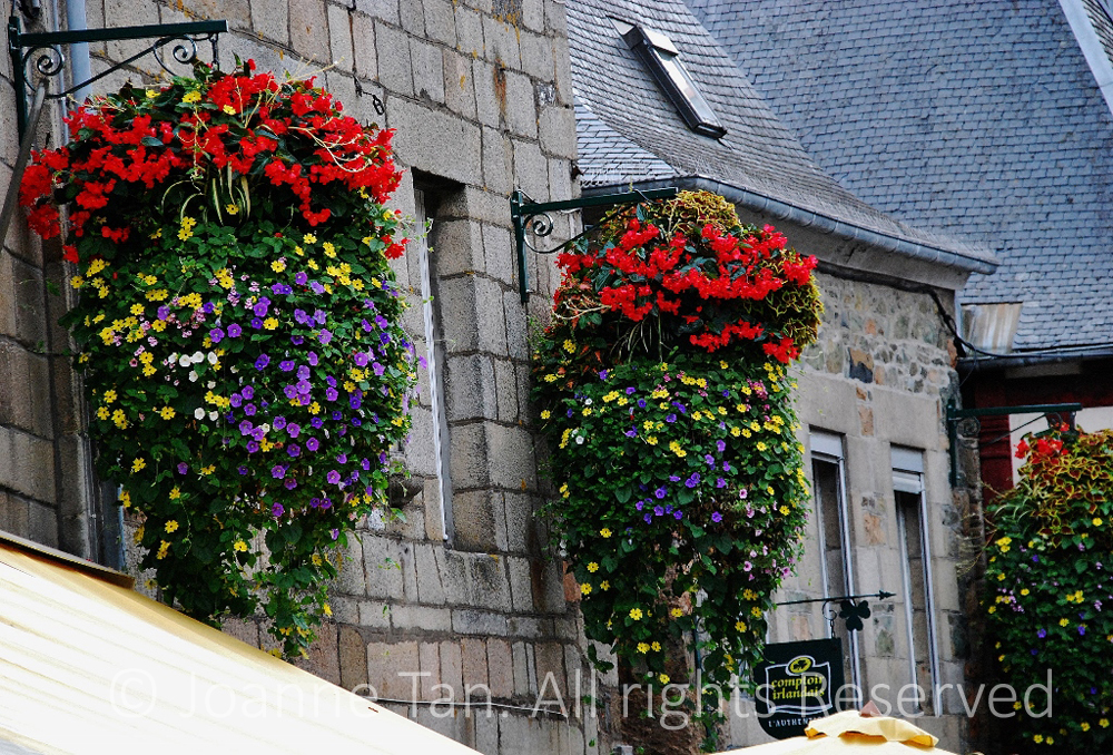 p- architecture - hanging baskets of flowers & stone buildings - Brittany, France